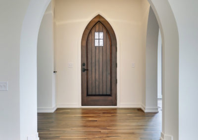 Entryway with Arched Door and Archways
